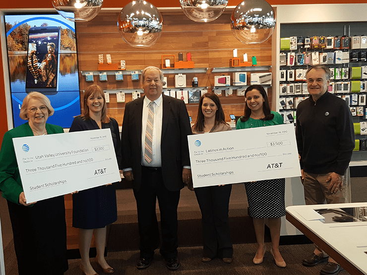Check Presentation for Student Scholarships (L to R): Nancy Smith (green), Utah Valley University; Tara Thue, AT&T Director of External Affairs; Mayor Brunst (middle); Elizabeth and Jackie Perkins, Latinos in Action.