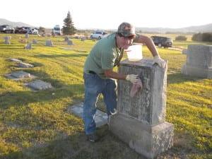 Kaleb Richardson cleaning a headstone.
