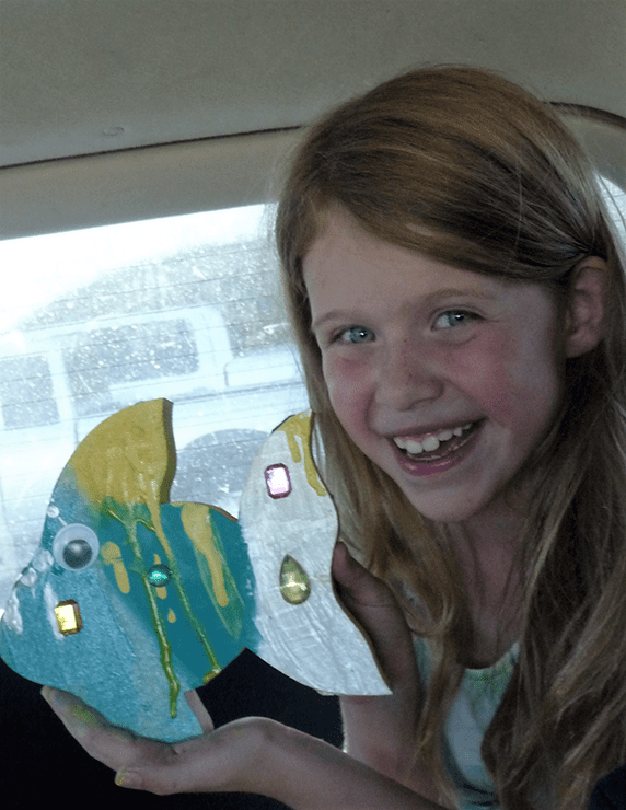 Eliza and fish craft painted at Lulu's Crafty Corner.