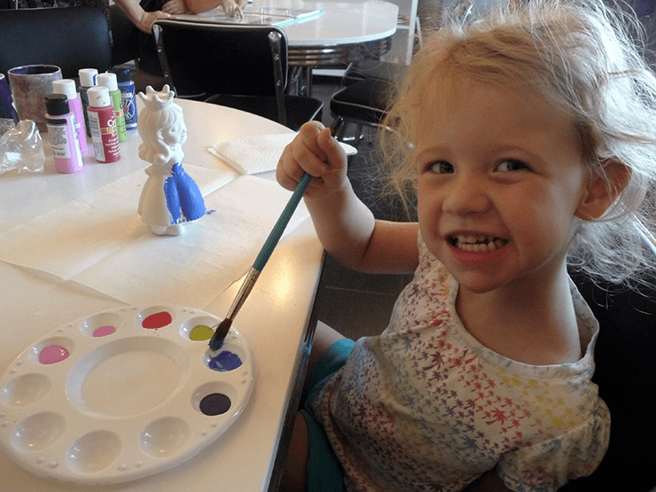 Olivia painting ceramic at Lulu's Crafty Corner in Payson.
